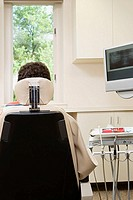 Rear view of person in dentist chair (thumbnail)
