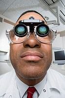 Dentist wearing dental binocular loupes
