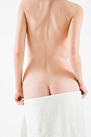 Naked woman with towel