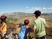 Cyclist father and children looking at view (thumbnail)