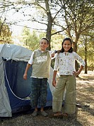Boy and girl by tent