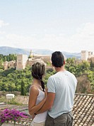 Couple looking at alhambra palace