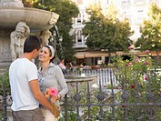 Romantic couple in town square