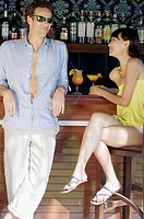 couple relaxing and drinking at bar