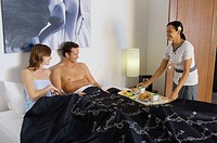 couple having breakfast served on bed