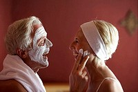 senior couple, facial care, mutually, laugh, apply, side portrait,