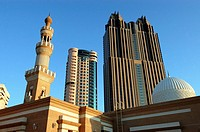 Skyscrapers and mosque along Sheikh Zayed Road. Emirate of Dubai. United Arab Emirates on the Persian Gulf