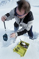 Measuring snow density at a weather station in Swedish Lapland  A known volume of snow is placed in the container and weighed, allowing its density, a...