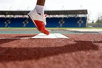 Athlete´s foot lifting off the take-off point while performing a long jump  In athletics the long jump is a track and field event in which the athlete...