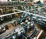 Oil drum production line  Workers and machines manufacturing oil drums at a factory  Thousands of barrels of oil are used worldwide every year, and ne...