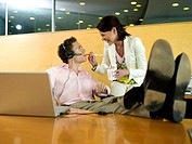 Couple having lunch break in office