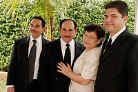 Home wedding, Jehovah´s Witnesses, Hispanic family, relatives, groom, mother, father, brother. Miami. Florida. USA.