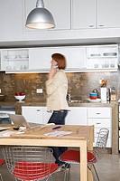 Businesswoman walking through kitchen area