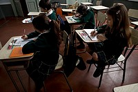 Young students working at their desks in class