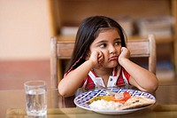 Young girl refusing to eat