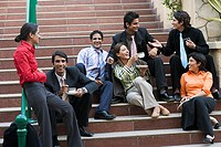 Businesspeople relaxing on outdoor staircase