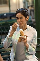 Woman eating ice cream in a park