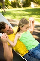 Father and daughter on slide (thumbnail)