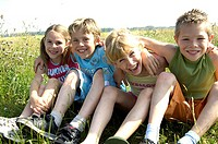 Children, meadow, sit, laughs, group-picture, series, people, girls, boys, friends, arm in arm, gaze camera, cheerfully, friendship, cohesion, childho...