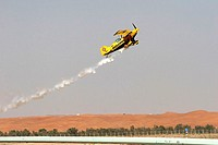 Propeller-airplane, start, 2006 Al Ain air-shows, Arabic emirates, only editorially, Babylon-Freefly S L , flight-show, art-planes, smoke, heavens, ac...