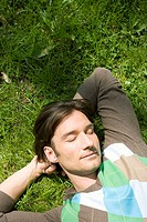 Man, sleeps, lies, meadow, portrait, from above, series, people, 30-40 years, dark-haired, leisurewear, sweaters, leisure time, recuperation, relaxati...