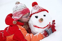 Girls, cheerfully, fun, snow, play, snowman builds, embraces, kisses, child, 5-8 years, outside, winters, glasses, winter-clothing, cap, gloves, child...