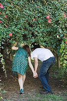 Couple walking under vine