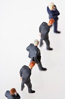 Businessmen figurines standing in a row