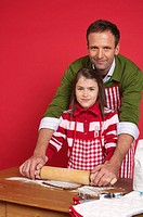 Father and daughter baking Christmas cookies