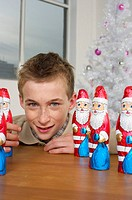 Boy looking at camera, Santa Claus chocolates on a table