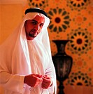 Arab man with mosbah in his hands