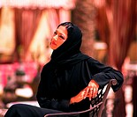 Arab Woman sitting on a chair outdoors