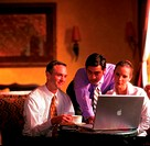 Businesspeople using a laptop (thumbnail)
