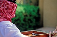 Arab man playing backgammon