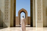 Muslim praying in the Grand Mosque in Muscat, Oman