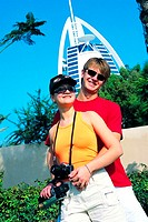 Western tourist couple in front of Burj Al Arab hotel in Dubai, UAE