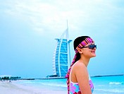 Tourist on the beach near Burj Al Arab hotel in Dubai, UAE