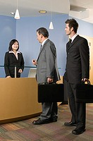 Businessmen at a reception desk