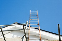 Ladder and scaffold on side of house