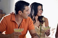 Close-up of a mid adult couple holding margaritas