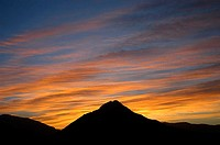 Silhouette of a hill at sunrise