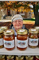 Vendor of home made preserves, pickles and relishes sells her product directly to the public from farmstand