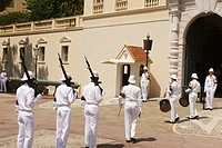 Changing of the guard prior to midday outside the Palais du Prince in Monaco.  The daily event is watched enthusiastically by visitors to the principa...