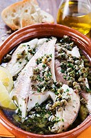 Fish fillets in olive oil with capers