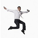 Portrait of a businessman jumping