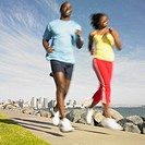 African couple in athletic gear jogging