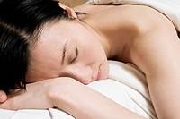 Asian woman receiving massage