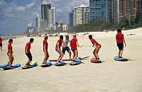 Students learning to ride a board on the Gold Coast. The region has produced many world-class surfers. 2005. Gold Coast. Queensland. Australia
