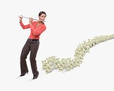 Studio shot of dollar bills following woman playing flute