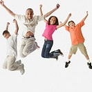 Studio shot of children jumping